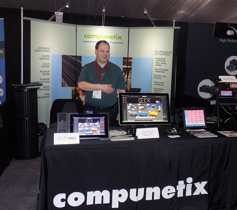 Chris Fry (Program Manager with Federal Systems Division) at the Compunetix booth at a previous Space Symposium show